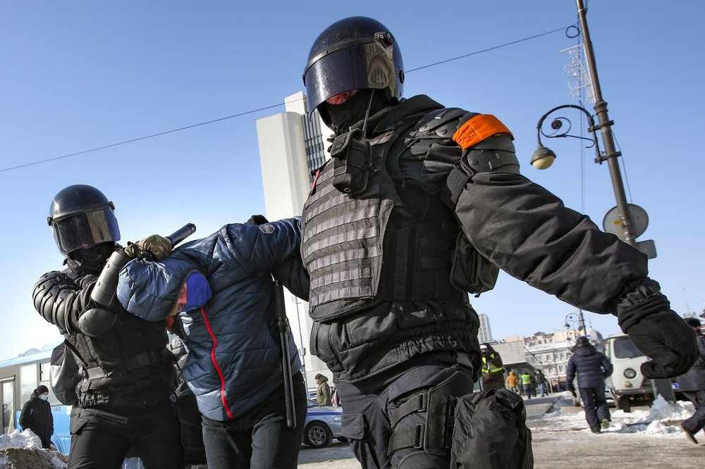 Police Officers Detain A Man During A Protest Against The Jailing Of Opposition Leader Alexei Navalny In Vladivostok