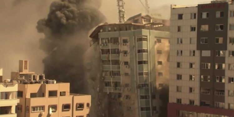 israel strike in gaza destroys building
