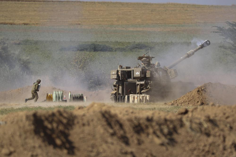 israeli artillery unit fires toward targets in the gaza strip