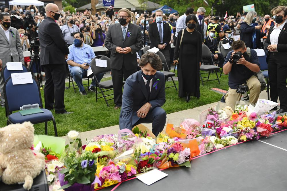 canada's prime minister justin trudeau lays flowers at a vigil outside the london muslim mosque for the victims of the deadly vehicle attack