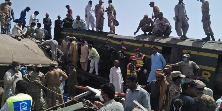 train barrels into another in pakistan, killing at least 40